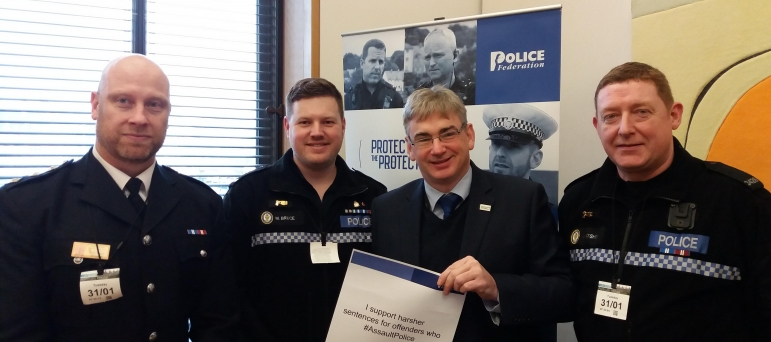 Julian Knight MP with police.
